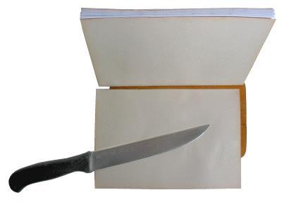 Buch binden - Beschneiden des Rückens.